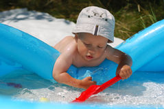 Little baby playing in water Stock Photo