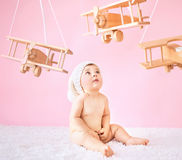 Little baby playing wooden toy planes. Little girl playing wooden toy planes Royalty Free Stock Photography