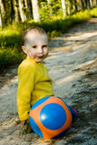 Little baby plays with ball Stock Images