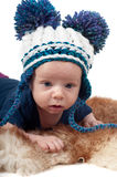 Little baby in pom-pon hat Stock Photo