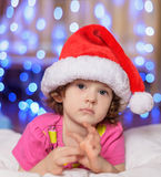 The little  baby in a red cap Royalty Free Stock Images