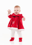Little baby in red dress on a white background Stock Photo