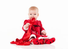 Little baby in red dress on a white background Stock Photography