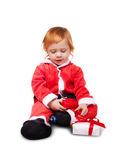 Little baby in red suite isolated Stock Image