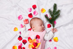 Little baby with rose petals Stock Image