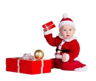 Little baby Santa with Christmes prenets Royalty Free Stock Photos