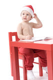 Little baby in santa suit Stock Images