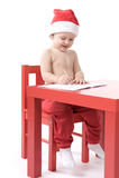 Little baby in santa suit Stock Photo
