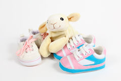 Little baby shoes. And sheep over white background Stock Image