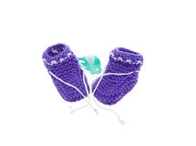 Little baby shoes. Hand knitted shoe for newborn boy or girl. Crochet handmade bootees on white background Stock Images
