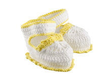 Little baby shoes. Hand knitted sneakers for newborn boy or girl. Crochet handmade bootees on white background Royalty Free Stock Photography