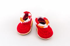 Little baby shoes. Kids knitted shoe handicraft. Little baby shoes. Kids knitted shoe handicraft on white background Royalty Free Stock Photography