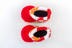 Little baby shoes. Kids knitted shoe handicraft. Little baby shoes. Kids knitted shoe handicraft on white background Royalty Free Stock Image
