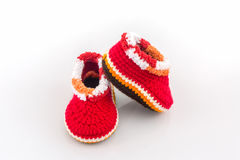 Little baby shoes. Kids knitted shoe handicraft. Little baby shoes. Kids knitted shoe handicraft on white background Stock Photo