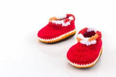 Little baby shoes. Kids knitted shoe handicraft. Little baby shoes. Kids knitted shoe handicraft on white background Royalty Free Stock Images