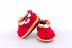 Little baby shoes. Kids knitted shoe handicraft. Little baby shoes. Kids knitted shoe handicraft on white background Stock Photography