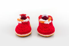 Little baby shoes. Kids knitted shoe handicraft. Royalty Free Stock Photography