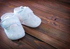 Little baby shoes. On a table Stock Photo
