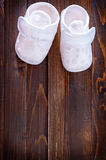 Little baby shoes. On a table Stock Photography