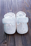 Little baby shoes. On a table Stock Image