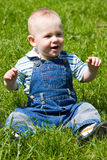 Little baby sit on grass Stock Image