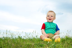 Little baby sit on green grass Royalty Free Stock Photo