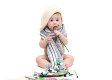 Little baby sitting with paints Royalty Free Stock Photos