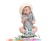 Little baby sitting with paints Royalty Free Stock Images