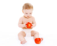Little baby sitting with reds apples Stock Images