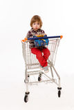 Little baby sitting in shopping cart Royalty Free Stock Photo