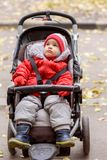 Little baby is sitting in a stroller royalty free stock photos