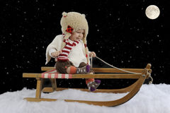 Little baby on a sledge Stock Photography