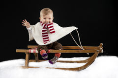 Little baby on a sledge Royalty Free Stock Images