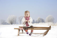 Little baby on a sledge Stock Image
