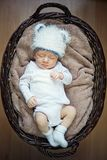 Little baby sleeping in basket. Stock Photos