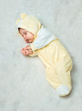 Little baby is sleeping  on the carpet Royalty Free Stock Images