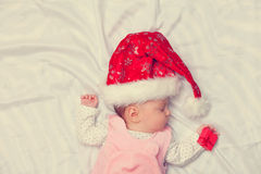 Little baby sleeping with christmas gifts Royalty Free Stock Photography