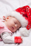 Little baby sleeping with christmas gifts Royalty Free Stock Image