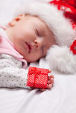 Little baby sleeping with christmas gifts Stock Photos