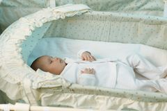 Little baby sleeping in the manger Stock Photos