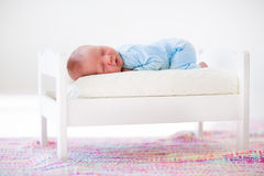 Little baby sleeping in toy bed Royalty Free Stock Photo