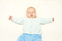 Little baby sleeping on a white background Stock Photos