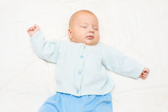Little baby sleeping on a white background Stock Image