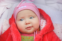 Little baby smiling in the perambulator Royalty Free Stock Image