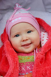 Little baby smiling in the perambulator Royalty Free Stock Images