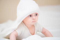 Little baby smiling under a  towel Stock Photo