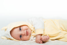 Little baby is smiling in the yellow shirt Stock Photo