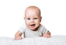 Little baby is smirking on the carpet Stock Photo