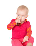 Little baby girl spraying herself nose spray Stock Photos