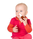Little baby girl spraying herself nose spray isolated on white Stock Image